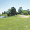 A view of a green protected by bunkers at South Winds Golf Club