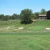 A view of a green flanked by bunkers at Plum Hollow Country Club