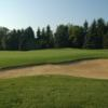 A view of a green protected by bunkers at Kingsville Golf and Country Club