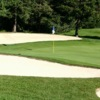 A view of the 1st hole protected by bunkers at Brookwood Golf Club