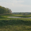 A view of a green protected by bunkers from The Links at Ivy Ridge