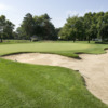 A view of a green protected by a large bunker at Niagara Falls Country Club