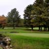 A view of a green with water coming into play at Pleasant Valley Country Club