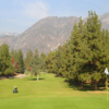 A view of a hole with mountains in background at Eaton Canyon Golf Course