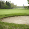A view of a hole protected by a bunker at Brockton Country Club