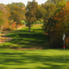 A view of a hole with a narrow cart path on the left side at Leicester Country Club