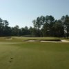 A view of the 15th green surrounded by bunkers at Furman University Golf Course