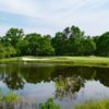 A view of a green with water coming into play at Blue Heron Pines Golf Club