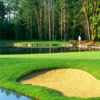 A view of a green surrounded by water at the Golf Club at Redmond Ridge