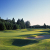A view of the 18th green protected by sand traps at Indian Summer Golf & Country Club