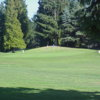 A view of a green flanked by bunkers at Fairwood Country Club