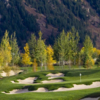 A fall view of a hole surrounded by bunkers at Maroon Creek Club