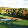 A view of a green protected by a pond and bunkers at Wampanoag Country Club