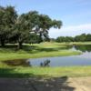 A view over the water of a green at Gemstone Plantation Country Club