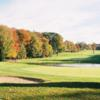 A view of a green with water coming into play at Twin Hills Country Club