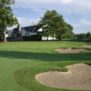 A view of a green protected by bunkers at Northport Point Golf Club
