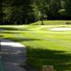 A view of a hole guarded by sand traps at Hale's Location Country Club