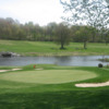 A view of a green with water and bunkers coming into play at Turtle Creek Golf Course At Garden Cathay