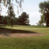 A view of a green protected by bunkers at Whip-Poor-Will Golf Course