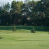 A view of a green protected by bunkers at Sherwood Forest Country Club