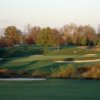 A view of a green surrounded by tricky bunkers at Cherry Valley Country Club