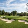 A view of a green surrounded by a collection of tricky bunkers at Country Club of Darien