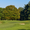A view of a green surrounded by bunkers at Monroe Golf Club