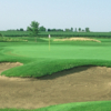 A view of a hole protected by bunkers at Prairie Green Golf Course