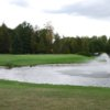 A view of a green with water coming into play at Wander Springs Golf Course