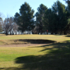 A sunny day view of a green at Arroyito Country Club