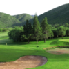 A view of a green protected by bunkers at Cochabamba Country Club