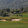 A view of a green protected by a bunker at Hacienda Santa Martina Nature Club & Golf