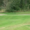 A view of a green protected by bunkers at Cuenca Golf Club