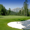 A view of a green with mountains in the distance at Achensee Golf Club