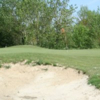 A view of the 9th green guarded by a bunker at Martines Golf Club