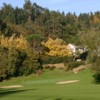 An autumn view of a green flanked by sand traps at Mazamet - La Barouge Golf Club