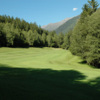 A view of a fairway with mountains in the distance at Chamonix Golf Club