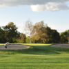 A view of a green guarded by sand traps at Haggin Oaks Golf Course