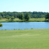 A view over the water of the 12th green at Virginia Beach National Golf Club