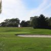 A view of a green protected by a bunker at Clecy Golf Club