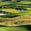 A view of a green protected by tricky sand traps at Country Hills Golf Club