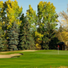 A view of a hole protected by bunkers at Canyon Meadows Golf and Country Club