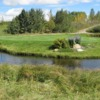 A view of a hole surrounded by water at Beaver Dam Golf Course