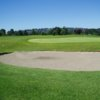 A view of a hole protected by a bunker at Eaglequest Golf Club