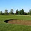 A view of a green protected by bunkers at Pine View Golf Course
