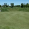 A view of a green and a narrow cart path on the left side at Anderson Links Golf & Country Club