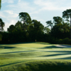 View of a green and fairway at St. Lucie Trail Golf Club