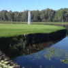 A view of a green surrounded by water at Schloss Teschow Golf Club