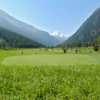 A sunny day view of a hole at Matterhorn Golf Club