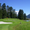 A view of a hole protected by a bunker at Golf Club St. Moritz